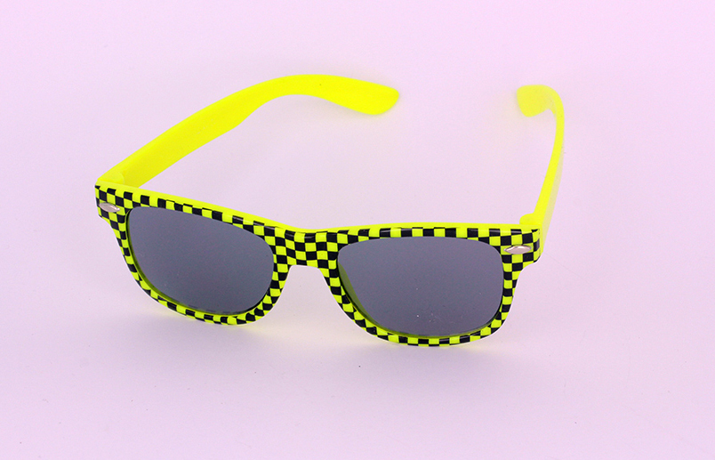 Sunglasses for children in checkered black and neon yellow
