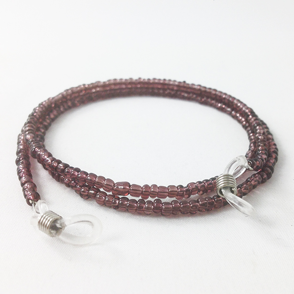 Glasses cord with purple pearls.