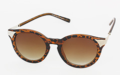 Round sunglasses in tortoiseshell with gold corners