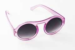 Large round sunglasses in purple. Slightly transparent design